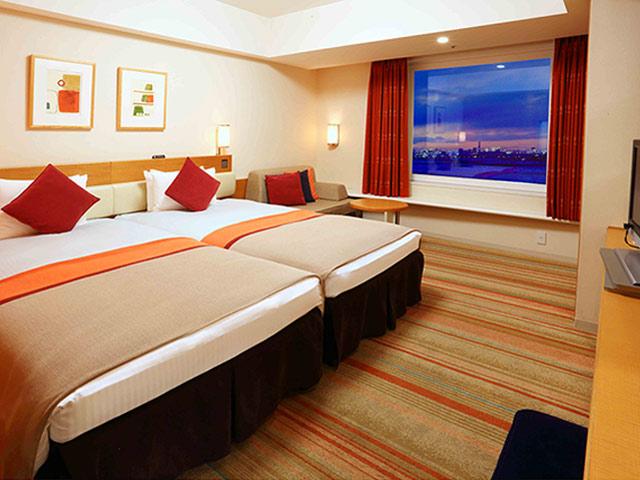 ベッドは2台並んだハリウッドスタイル。添い寝も安心
